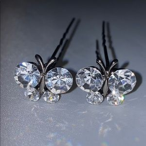 Pair of clear crystal butterfly hair pins.  New.